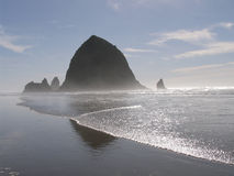 Haystack Rock, Oregon coast. Haystack Rock, Oregon is the third largest coastal monolith in the world. It is a designated marine and bird sanctuary Stock Photos