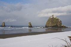 Haystack Rock with snow Royalty Free Stock Photography