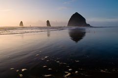 Haystack Rock Sunset. Cannon Beach, Oregon's iconic seastack plies a waning tide near sunset Royalty Free Stock Image