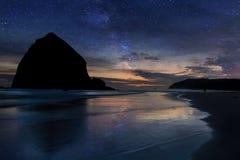 Haystack Rock under Starry Night Sky along Oregon coast Stock Photos