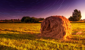 Haystack and stars Stock Photography