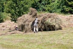Haystack worker Stock Image