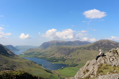 Haystacks, Buttermere, Crummock Water, Grasmoor. View from the north west end of Haystacks Hay Stacks in the English Lake District. A hillwalker is sat on a Stock Photo