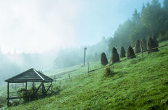 Haystacks. On the Carpathian hills in the fog Royalty Free Stock Image