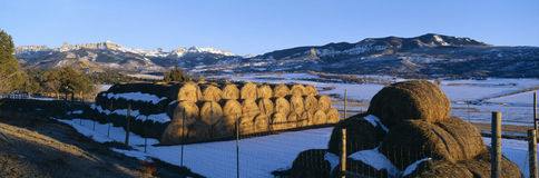 Haystacks and Cimarron Mountains Royalty Free Stock Image