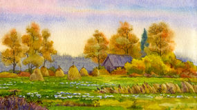 Haystacks on field. Watercolor landscape. Stack of hay in the autumn meadow near the barn Royalty Free Stock Images