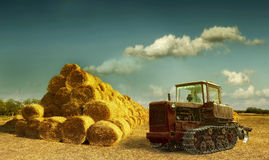 Haystacks on the field. old tractor and hay stack Royalty Free Stock Photos