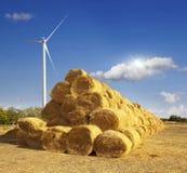 Haystacks on the field. windmill Stock Photo