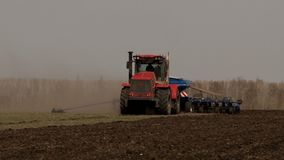 Agricultural tractor digging the ground stock video footage