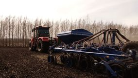 Agricultural tractor digging the ground stock video