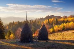 Haystacks in mountain village Stock Image