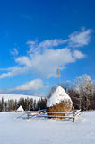 Haystacks in the mountains. Of bright frosty winter day Stock Photo