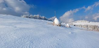 Haystacks in the mountains. Of bright frosty winter day stock photography
