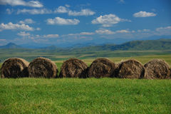 Haystacks in the mountains Stock Image