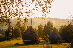 Haystacks in the mountains at sunset royalty free stock photography
