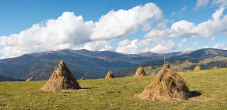 Haystacks on plateau Stock Photography