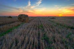 Haystacks.Sunset on the field Royalty Free Stock Photo