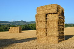 Haystacks in a Sussex crop field. Royalty Free Stock Photography