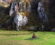 Lonely haystack in an enclosure at the foot of the mountain, Fundatura Ponorului stock images