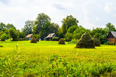 Haystacks and wooden houses Royalty Free Stock Images