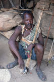 Hazabe bushman of the hadza tribe preparing arrows for hunting Stock Photos