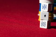Hazard. Poker's Dice and chips on a red cover royalty free stock images