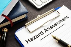 Hazard assessment form with clipboard on a desk stock photography