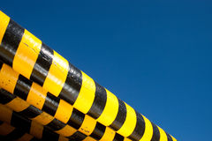 Hazard Barriers. Hazard barricades piled up against a deep blue sky for copy space royalty free stock photography