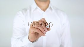 Hazard, Businessman Writing on Glass. High quality stock images