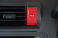 Hazard button in front car console. Car emergency warning light button in front car console stock image