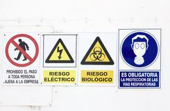 Hazard and danger signs Stock Images