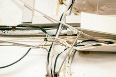 Hazard electrical wiring. Exposed wire in the electrical wiring in the wall Stock Photos