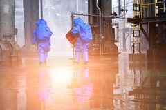 Hazard emergency response concept. Chemical spill lution response team in action recovery stop spill of the chemical spill lution at factory . Hazard emergency royalty free stock photos