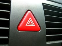 Hazard flasher. A button in form of a triangle for hazard flasher Royalty Free Stock Image