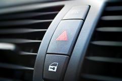 Hazard lights. A button on a modern car dashboard to activate hazard lights stock image