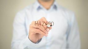 Hazard , Man writing on transparent screen. High quality royalty free stock image