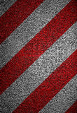 Hazard markings on road. Closeup of red striped hazard marking on asphalt road surface stock photos