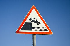 Hazard road signs on sky background. Near sea coast in harbor area stock photography