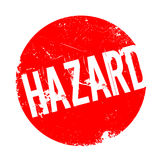 Hazard rubber stamp Stock Images