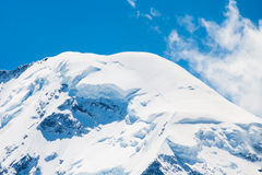 Hazard snow. Mountain peak covered with snow. There is a hazard of avalanche stock photography