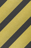 A hazard stripes background with grungy seamlessly. As  a pattern in any direction Royalty Free Stock Image
