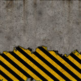 Hazard stripes torn wall Royalty Free Stock Photo