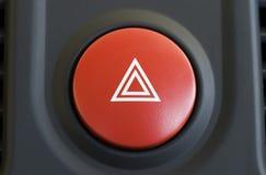 Hazard warning. A large red hazard warning light button royalty free stock image