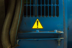 Hazard warning attention sign on engine of electric generator.  royalty free stock photo