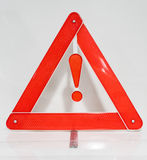 Hazard warning attention sign with exclamation mark symbol. Made of plastic with red reflection cover Stock Images