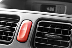 Hazard warning light switch. Photo of interior car hazard warning light switch with triangle sign stock photo