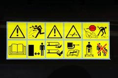 Hazard warning symbols. Public hazard warning information symbols against a black background stock photos