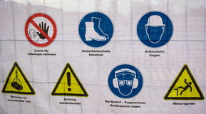 Hazard warnings-Hamburg. This photo was taken in front of a site in Hamburg. It shows a variation of hazard warnings. From 27th of Decembre 2014 royalty free stock photo