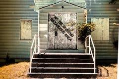 Hazardous Area. Sign warns No Trespassing Hazardous Area on abandoned building stock photos