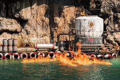 Hazardous chemicals leakage was burning down. In the sea stock image